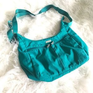 Baggallini turquoise green cross body canvas bag